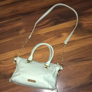 Turquoise Steve Madden purse, with gold details.